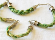 Silver and string necklace by Lillyan Shirvington